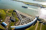 Nederland, Zuid-Holland, Rotterdam, 18-02-2015; Maeslantkering in de Nieuwe Waterweg. De stormvloedkering bestaat uit twee deuren die klaar liggen in een dok en welke sluiten bij een waterstand van 3 meter of meer boven NAP. De kering, laatst voltooide onderdeel van Deltawerken, beschermt Rotterdam en achterland bij extreme waterstanden.<br /> The new storm surge barrier (Maeslantkering) in the Nieuwe Waterweg (New Waterway, the entrance to the port of Rotterdam). In case of storm floods, the two enormous doors will close of the waterway protecting Rotterdam and its hinterland.<br /> luchtfoto (toeslag op standard tarieven);<br /> aerial photo (additional fee required);<br /> copyright foto/photo Siebe Swart