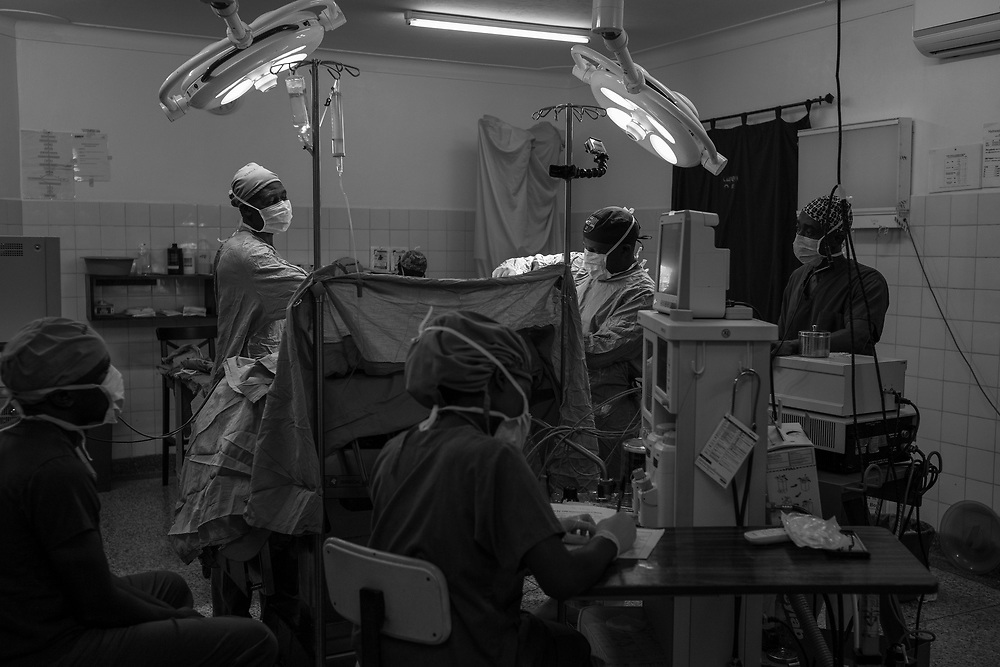 Doctors operate on a patient at Cure Children's Hospital in Mbale, Uganda on February 6, 2017. The hospital has performed more than 10,000 life-saving surgeries on children with hydrocephalus.
