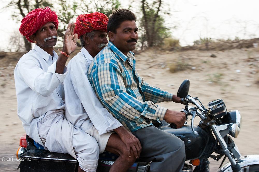 Three men on a motorbike