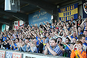 AFC Wimbledon fans celebrating during the EFL Sky Bet League 1 match between AFC Wimbledon and Bury at the Cherry Red Records Stadium, Kingston, England on 5 May 2018. Picture by Matthew Redman.