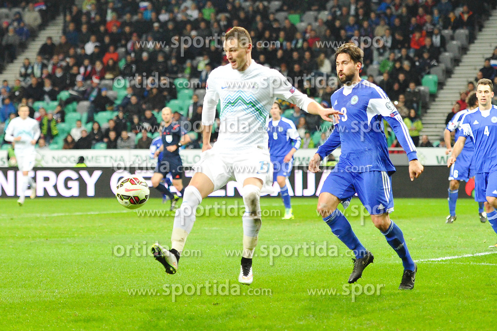 Novakovic Milivoje of Slovenia vs Palazzi Mirko of San Marino during football match between NationalTeams of Slovenia and San Marino in Round 5 of EURO 2016 Qualifications, on March 27, 2015 in SRC Stozice, Ljubljana, Slovenia. Photo by Mario Horvat / Sportida