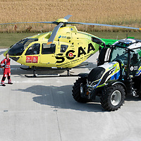 SCAA…Scotland's Charity Air Ambulance 'Helimed 76' pictured with Police Scotland's tractor ahead of the Perth Show on the 4/5th August…The tractor has been loaned to Police Scotland Specialist Crime Division who are responsible for rural and agricultural crimes, pictured from left paramedic Darren O'Brien, PC Frank Donald Police Scotland Roads Policing Unit and paramedic Rich Garside<br />see story by Maureen Young on 07778 779888 or maureenyoung001@gmail.com <br />Picture by Graeme Hart.<br />Copyright Perthshire Picture Agency<br />Tel: 01738 623350  Mobile: 07990 594431