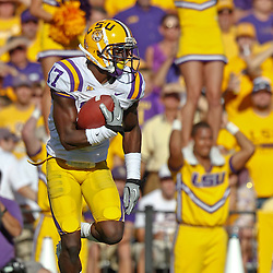 October 8, 2011; Baton Rouge, LA, USA; LSU Tigers kick returner Morris Claiborne (17) runs back a kickoff against the Florida Gators during the third quarter at Tiger Stadium. LSU defeated Florida 41-11. Mandatory Credit: Derick E. Hingle-US PRESSWIRE / © Derick E. Hingle 2011