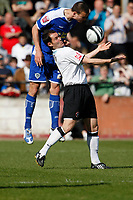 Photo: Steve Bond/Richard Lane Photography. Hereford United v Leicester City. Coca Cola League One. 11/04/2009. Jack Hobbs (L) gets above Steve Guinan (R)
