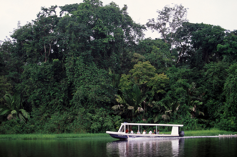 Boat with tourists in Tortuguero National park in Costa Rica.