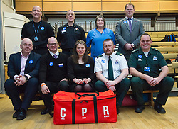 Pictured: Back Row; Inspector Jim Young, Police Scotland, David Farries , Local senior officer SFRS, Caroline Hughes SAS and James Cant, Director BHF Scotland, Front row; Gareth Clegg, Chair OHCA Delivery Group NHS LOthian, Mark Balard, Director of Strategy and Communications, Chest, Heart and Stroke Scotland, Aileen Campbell, Dave Bywater, Consultant Paramedic National OGCA lead Scottish Ambulance Service, and Steven Short OHCA Clinical Effectiveness Lead SAS, <br /> Minister for Public Health Aileen Campbell joined P7 and S1 students at Beeslack High School in Penicuik for CPR training session attended by representatives from NHS, Police, fire and ambulance services.<br /> <br /> <br /> Ger Harley | EEm 24 November 2016