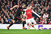 Arsenal Defender Nacho Monreal (18) and  AC Milan Defender Leonardo Bonucci (19) in action during the Europa League match between Arsenal and AC Milan at the Emirates Stadium, London, England on 15 March 2018. Picture by Stephen Wright.