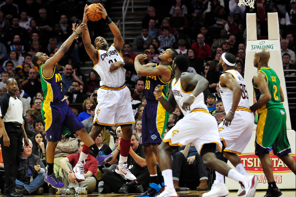 March 6, 2011; Cleveland, OH, USA; New Orleans Hornets point guard Chris Paul (3) and power forward David West (30) fight Cleveland Cavaliers power forward Samardo Samuels (24) for a rebound during the second quarter at Quicken Loans Arena. Mandatory Credit: Jason Miller-US PRESSWIRE