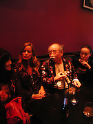 Jade Jagger, Nobuyoshi Araki  and Komari. Party given for Nobuyoshi Araki by White Cube after the opening of his Self'Life'Death exhibition at the Barbican. Zyrus/Genesys Karaoke bar. Clerkenwell Rd. London. 5 October 2005. . ONE TIME USE ONLY - DO NOT ARCHIVE © Copyright Photograph by Dafydd Jones 66 Stockwell Park Rd. London SW9 0DA Tel 020 7733 0108 www.dafjones.com