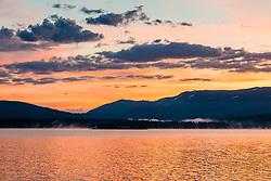 """Stampede Reservoir Sunrise 2"" - Photograph of an orange colored sunrise at Stampede Reservoir."