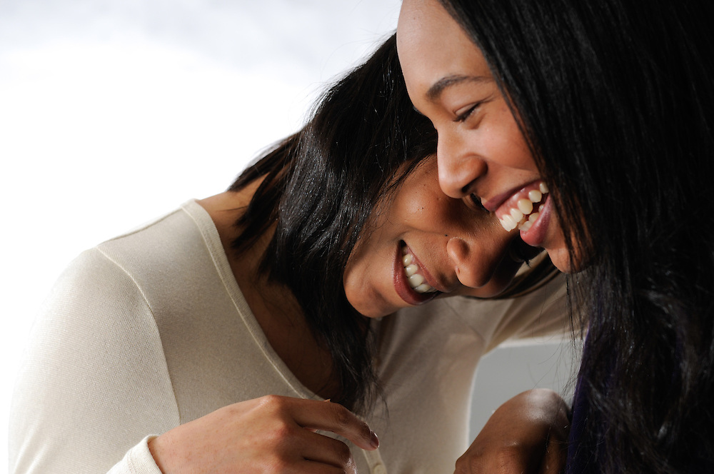 Two sisters share a laugh during a studio session at Mike's Studio 209 in Boston's South End.
