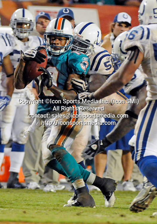 21 September 2009:  Indianapolis Colts linebacker Clint Session (55) tackles Miami Dolphins wide receiver Ted Ginn Jr. (19) in the Colts' 27-23 victory at Land Shark Stadium, Miami, Florida.
