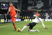 Derby County defender Fikayo Tomori wins the ball from Millwall midfielder Shane Ferguson during the EFL Sky Bet Championship match between Derby County and Millwall at the Pride Park, Derby, England on 20 February 2019.