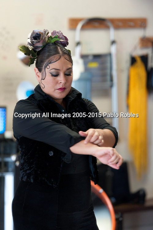Flamenco dancer Angelina Ramirez prepares for a dance demonstration in a dance studio in Downtown Phoenix on August 12, 2016. Ramirez is one of the owners of Flamenco Por La Vida dance studio. Singer Olivia Rojas and Flamenco dancer Angelina Ramirez co-owners of Flamenco Por La Vida dance studio in Downtown Phoenix, AZ.