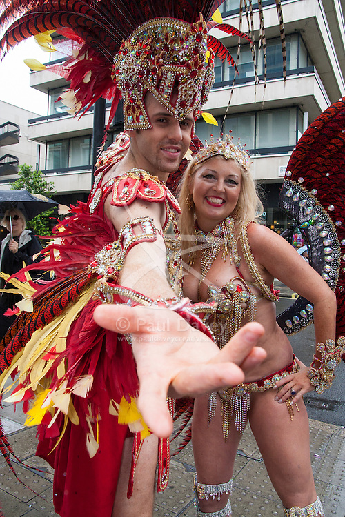 London, June 28th 2014. A magnificently costumed couple pose for the camera  as Gay Pride revellers assemble on Baker Street ahead of the parade.
