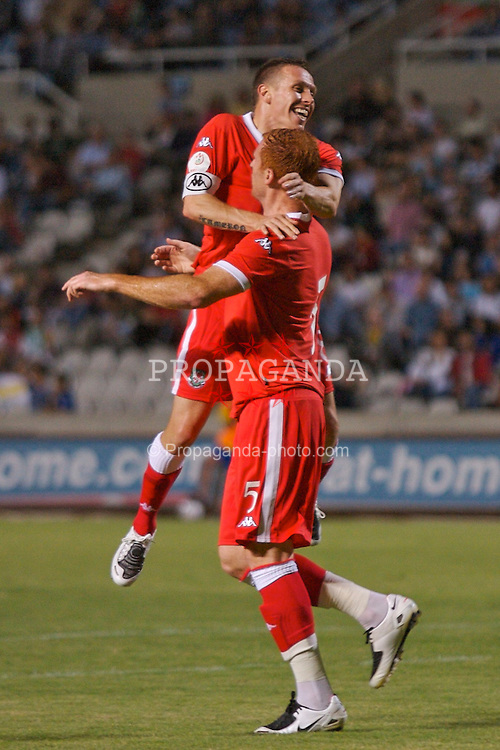 Nicosia, Cyprus - Saturday, October 13, 2007: Wales' James Collins celebrates his opening goal against Cyprus with team-mate and captain Craig Bellamy during the Group D UEFA Euro 2008 Qualifying match at the New GSP Stadium in Nicosia. (Photo by David Rawcliffe/Propaganda)