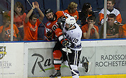 2012/03/16 - Niagara forward Scott Arnold checks RIT's Trevor Eckenswiller as fan Joe Cronin cheers during the Atlantic Hockey semifinal at the Blue Cross Arena in Rochester, N.Y. on March 16th, 2012. RIT defeated Niagara 2-1 in overtime.