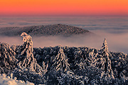 Mountain hills above a cover of clouds