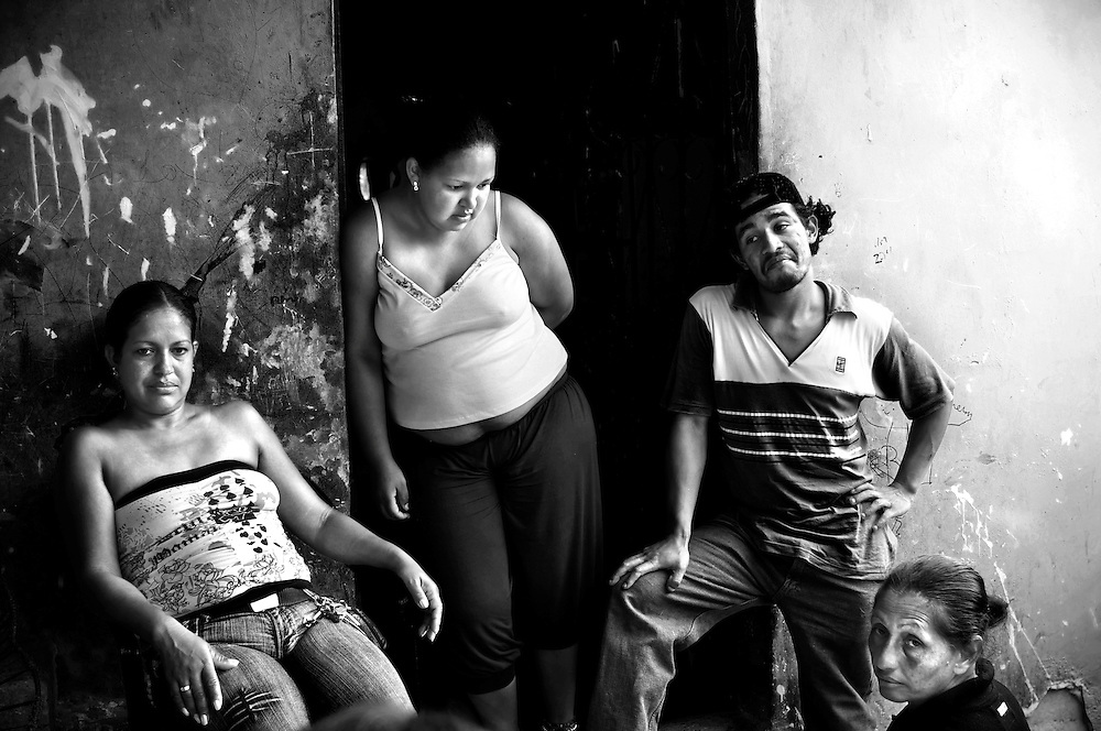 "Neighbors and family members return to their homes in the Petare slum after attending the funeral of Yanil Alexander Cemeño Figuera in Caracas, Venezuela. Cemeño was fatally shot in the street outside of their homes, and was his mother's fourth son to be murdered. His brother (second from left) shrugged after being asked how he felt about being his mother's only surving son. ""I guess I am next,"" he said.  The Petare slum is one of the most violent areas of Caracas, Venezuela, reporting over a dozen homicides every weekend. According to the ngo, the Venezuelan Observatory of Violence (OVV), Caracas has one of the highest violent crime rates in the world, with two people murdered every hour, a homicide rate that has quadrupled over the eleven year presidency of Hugo Chavez. Equally disturbing is the level of impunity, corruption and incompetency in the Venezuelan judicial system. OVV reports that 91% of crimes go unsolved in Venezuela."