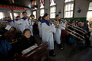 A Band plays at the beginning of a Christian church service in Pucheng, Shanxi.
