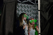 Two students pose for a photo in a photo booth at the Yell Like Hell Pep Rally. © Ohio University / Photo by Kaitlin Owens