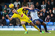 Shaquile Coulthirst of Southend (right) is beaten to the ball by Tom Flanagan of Plymouth Argyle, currently on load from MK Dons (left), during the Sky Bet League 2 match at Roots Hall, Southend<br /> Picture by David Horn/Focus Images Ltd +44 7545 970036<br /> 10/01/2015