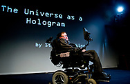 22-3-2014 - UTRECHT - Stephen Hawking during his speech, The Universe as a hologram in the Beatrix Theater in Utrecht. De Britse natuurkundige Stephen Hawking is op 76-jarige leeftijd overleden. In een verklaring laat de familie weten diep bedroefd te zijn. ,,Hij was een groot wetenschapper en een buitengewone man wiens werk en nalatenschap nog vele jaren zullen voortleven.&quot; De astrofysicus leed aan de neurologische ziekte ALS. De wetenschapper kon uitsluitend met een spraakcomputer communiceren en bewoog zich al tientallen jaren per rolstoel voort.<br />  COPYRIGHT ROBIN UTRECHT