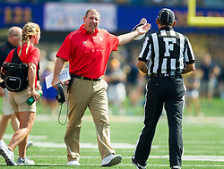 Sep 10, 2016; Morgantown, WV, USA; Youngstown State Penguins head coach Bo Pelini reacts after a penalty during the second quarter against the West Virginia Mountaineers at Milan Puskar Stadium. Mandatory Credit: Ben Queen-USA TODAY Sports