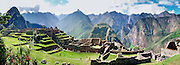 """Machu Picchu is a magnificent Inca archeological site in the Cordillera Vilcabamba, Andes mountains, Peru, South America. Machu Picchu was built around 1450 AD as an estate for the Inca emperor Pachacuti (14381472). Spaniards passed in the river valley below but never discovered Machu Picchu during their conquest of the Incas 1532-1572. The outside world was unaware of the """"Lost City of the Incas"""" until revealed by American historian Hiram Bingham in 1911. Machu Picchu perches at 2430 meters elevation (7970 feet) on a well defended ridge 450 meters (1480 ft) above a loop of the Urubamba/Vilcanota River ( Sacred Valley of the Incas). UNESCO honored the Historic Sanctuary of Machu Picchu on the World Heritage List in 1983. Seven overlapping photographs by Carol Dempsey were stitched into this panorama. Published by Sierra Magazine, Sierra Club Outings September/October 2002. Published in a book in Paris, France. Published on a German tour operator's website."""