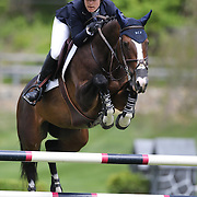 Sydney Shulman riding Venice in action during the $35,000 Grand Prix of North Salem presented by Karina Brez Jewelry during the Old Salem Farm Spring Horse Show, North Salem, New York, USA. 15th May 2015. Photo Tim Clayton