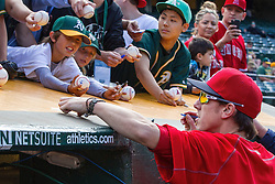 OAKLAND, CA - JUNE 17:  Tim Lincecum #55 of the Los Angeles Angels of Anaheim signs autographs outside the dugout before the game against the Oakland Athletics at the Oakland Coliseum on June 17, 2016 in Oakland, California. (Photo by Jason O. Watson/Getty Images) *** Local Caption *** Tim Lincecum