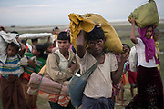 Saturday 11th November 2017. Newly arrived Rohingya refugees. Often described as the &quot;world's most persecuted minority&quot;, the Rohingya are a Muslim ethnic group from the Rakhine State in Myanmar. In October 2016, a military crackdown in the wake of a deadly attack on an army post sent hundreds of thousands of Rohingya fleeing to neighboring Bangladesh. <br /> <br /> This most recent exodus from Rakhine state, Myanmar, to the makeshift camps that have sprung up in Cox&rsquo;s Bazar District, began August 25, 2017, when militants from the Arakan Rohingya Salvation Army targeted about 30 police posts and an army base, killing several people.<br /> <br /> A daily occurrence, some arrive in the dark of night by fishing boat, where they wait, wet and shivering, on the beach until first light.  Others wade across the river at low tide at the Anjuman Para border crossing point. Photograph by David Dare Parker