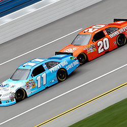 April 15, 2011; Talladega, AL, USA; NASCAR Sprint Cup Series driver Joey Logano (20) bump drafts Denny Hamlin (11) during practice for the Aarons 499 at Talladega Superspeedway.   Mandatory Credit: Derick E. Hingle