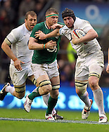 Picture by Paul Terry/Focus Images Ltd. 07545642257.17/03/12.Ben Morgon of England breaks away from Jamie Heaslip of Ireland during the RBS Six nations match at Twickenham stadium, London.