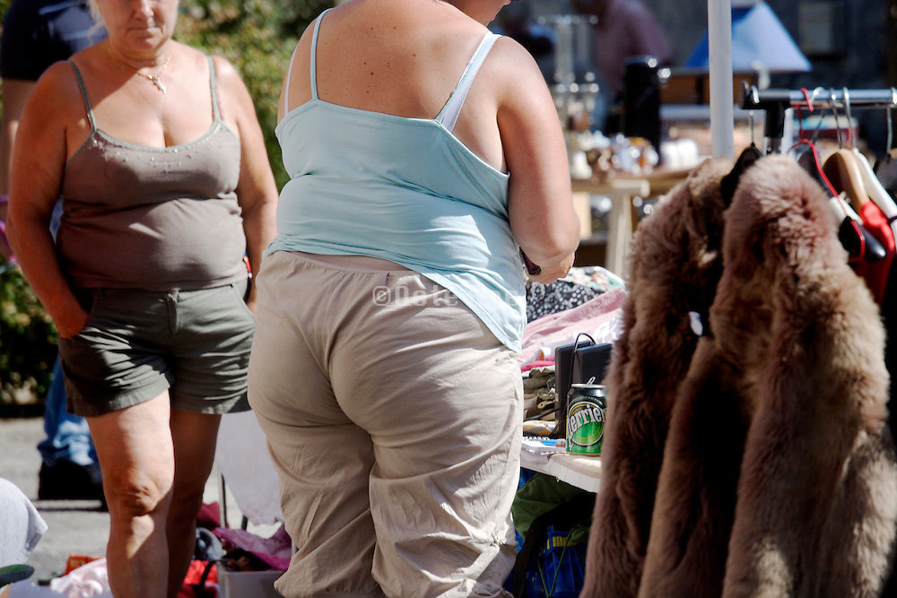 summer dressed obese females at a flee market