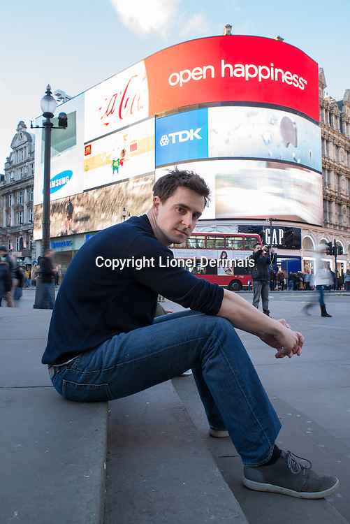 Lewis Dartnell astrobiology reseach scientist and author of The Knowledge - How to rebuild our world from scratch. Photographed Piccadilly Circus, London.