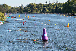 © Licensed to London News Pictures. 21/09/2019. LONDON, UK. 6,000 participants take part in the fourth Swim Serpentine, held in the famous lake in Hyde Park.  The event is raising thousands for Children With Cancer Charity UK as swimmers of all abilities navigate the one mile clockwise route around the lake.  Photo credit: Stephen Chung/LNP