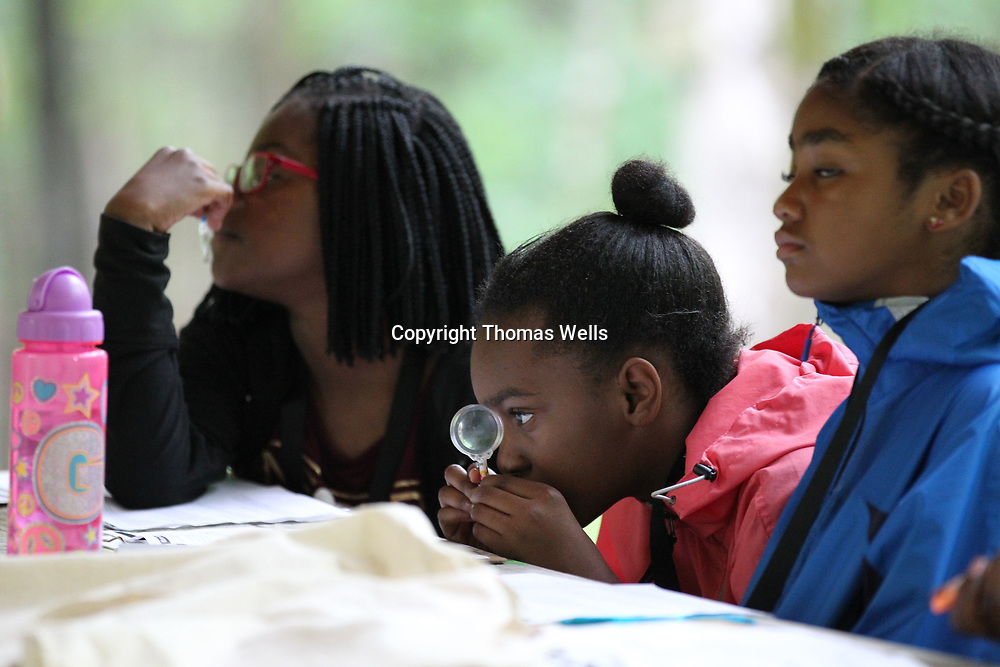 Kamryn Harris plays with her magnifying glass pen duirng Thursday's enviromental camp at the Natchez Trace Parkway.