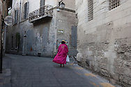 France. Bouches du Rhone.woman in a empty street  in Arles the old town