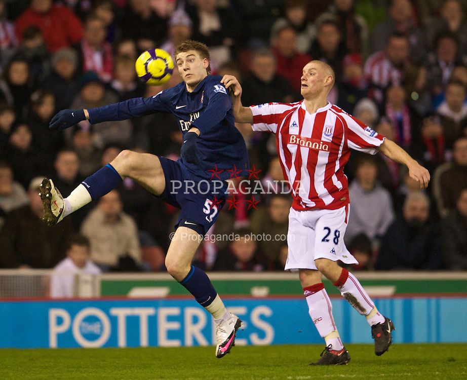 STOKE-ON-TRENT, ENGLAND - Saturday, February 27, 2010: Arsenal's Nicklas Bendtner and Stoke City's Andy Wilkinson during the FA Premier League match at the Britannia Stadium. (Photo by David Rawcliffe/Propaganda)