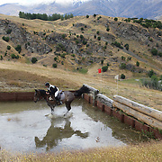 Verona Mitchell riding Soverign Fern in action at the water jump during the Cross Country event at the Wakatipu One Day Horse Trials at the Pony Club grounds,  Queenstown, Otago, New Zealand. 15th January 2012. Photo Tim Clayton
