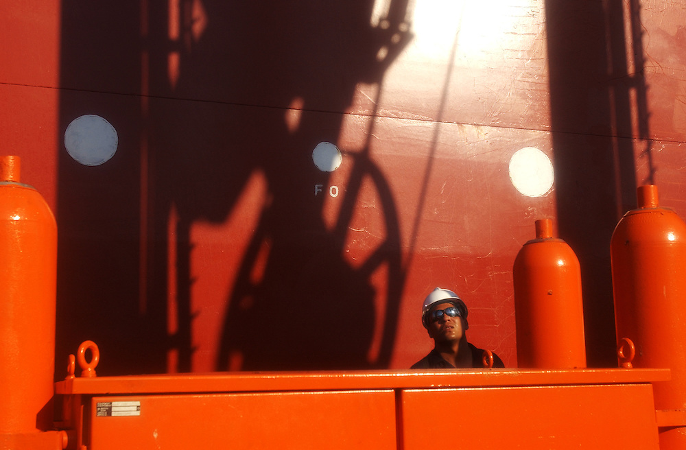 PDVSA worker Rangel Lozado on an off shore crude oil loading platform at the Jose complex