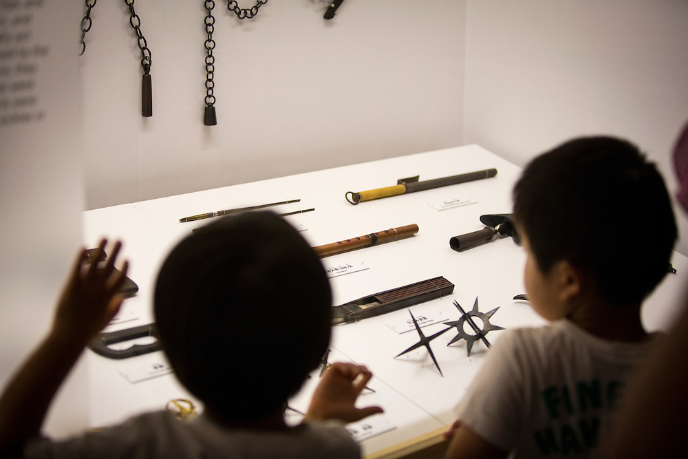 """TOKYO, JAPAN - JULY 2 : A Japanese boy look at ninja's weapon on display during a ninja exhibition that kicks off Saturday at Miraikan in Tokyo, Japan on July 2, 2016. A special exhibition entitled """"The Ninja- who were they?"""" will be open from July 2 (Saturday), 2016 to October 10 (Monday) 2016 at the Miraikan (National Museum of Emerging Science and Innovation). Photo: Richard Atrero de Guzman"""