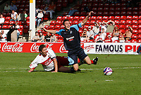 Photo: Steve Bond.<br />Walsall v Swansea City. Coca Cola League 1. 25/08/2007. Darryl Duffy (R) is sent sprawling by Ian Roper (L) for a penalty to Swansea