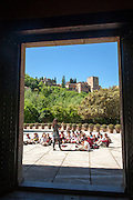 School children listen to their teacher on an educational visit to the historic sites of Granada, Spain