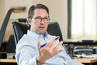 03 JUL 2019, BERLIN/GERMANY:<br /> Andreas Scheuer, CSU, Bundesminister fuer Verkehr und digitale Infrastruktur, waehrend einem Interview, in seinem Buero, Bundesministerium fuer Verkehr und digitale Infrastruktur<br /> IMAGE: 20190703-01-046