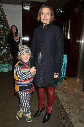 DAISY BATES and her son WOODY at the official opening of the 2014 Tiffany & Co.Christmas Shop on Bond Street, London on 16th November 2014.