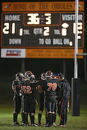 Springville head coach Joe Martin talks to his team during their game at Allison Field in Springville on Friday October 19, 2012. Midland defeated Springville 30-29.