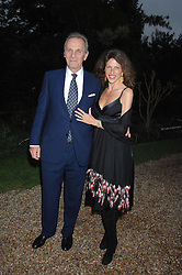 MARK & CLEO SHAND he is the brother of HRH The Duchess of Cornwall at the annual Cartier Chelsea Flower Show dinner held at the Chelsea Physic Garden, London on 21st May 2007.<br />