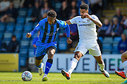 Gillingham FC forward Brandon Hanlan (7) and Coventry City defender Jordan Willis (4) during the EFL Sky Bet League 1 match between Gillingham and Coventry City at the MEMS Priestfield Stadium, Gillingham, England on 25 August 2018.